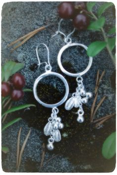 Spirit of a berry • silver earrings with casted lingonberry leaves. Handmade by Tytti Bräysy.  Inari (Lapland), Finland. www.paarmadesign.fi