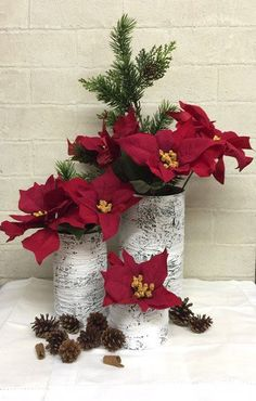 christmas birch center pieces diy - Empty cans painted as birch or wrapped with birch bark.