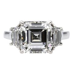 Cartier 3.17 Carat Three Diamond Platinum Engagement Ring   From a unique collection of vintage engagement rings at https://www.1stdibs.com/jewelry/rings/engagement-rings/