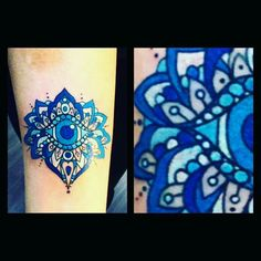 Blue evil eye tattoo