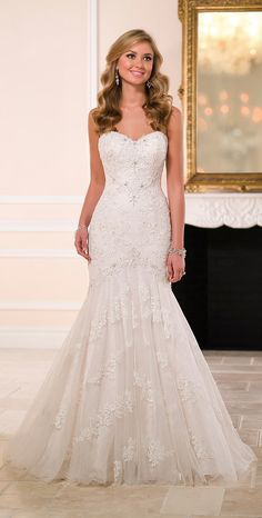 Stella York 2015 << not too crazy about the actual dress, but I love the hair!