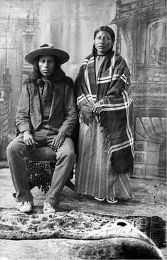 "thebigkelu: ""Studio portrait of an unidentified Native American Sioux man and woman in front of a painted backdrop - 1880/1891 """