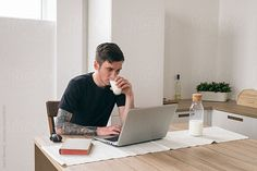 Young man drinking milk and working on laptop by Danil Nevsky - Man, Freelance - Stocksy United Laptop Photography, Boy Photography Poses, Marca Personal, Personal Branding, Computer Photo, Home Photo Shoots, Sem Internet, Ad Design, Lead Generation