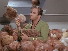 "Captain Kirk, up to his chest in tribbles in The Trouble with Tribbles--Just before the Klingon departure, all tribbles that were on the Enterprise are somehow beamed onto the Klingon ship by Chief Engineer Scott as a retaliation for the troubles the Klingons have caused, where, in his words, ""they'll be no tribble at all."""
