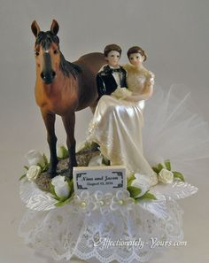 Two Trails Become One Horses With Bride and Groom Customized Wedding or Anniversary Cake Topper.  Shown In White With Ivory Accent With Bay Horse.  Personalized Dark Brown Hair On Bride and Groom.  Includes Personalized First Names and Date Plate.  http://www.affectionately-yours.com/two-trails-become-one-horses-wedding-cake-topper/