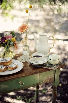 i like the green table which sets the stage for the tea party - fun vignette