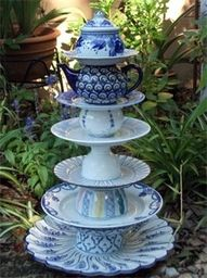 This is a original idea for a garden display for chipped, crazed and otherwise mismatched and abandoned china. Not sure I would went something this lovely outside though...