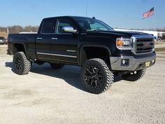 Black Lifted GMC Sierra truck