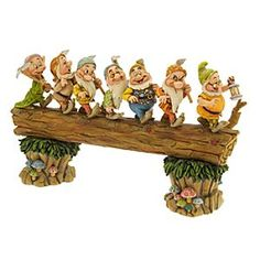 Disney ''Homeward Bound'' Seven Dwarfs Figurine by Jim Shore | Disney Store''Homeward Bound'' Seven Dwarfs Figurine by Jim Shore - Heigh ho! It's off to work we go. The Seven Dwarfs log on for another day in this wonderfully crafted <i>Snow White</i> figurine designed by artist Jim Shore, blending Disney Magic with American folk art to create an adorable piece with timeless appeal.