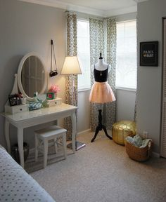 dress stand in corner. Maybe a chair like that for her desk that would go completely underneath it versus the chair she has now. Would give her just a tad more space.