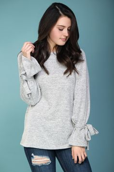 Simple winter fashion. A basic gray knit with tie-sleeves for a trendy detail.