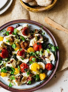 Late summer on a plate: warm tomatoes top chunks of silky mozzarella and the peppery watercress adds a light freshness to the dish.