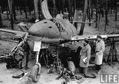 http://i53.photobucket.com/albums/g64/PoorOldSpike/Photos%20Two/frankftmay45.jpg American(?) officers inspect a partially dismantled Messerschmitt Me262, the world's first operational jet-powered fighter aircraft. Frankfurt, May 1945