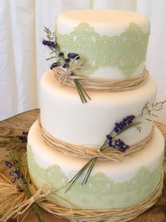 Midsummer Night's Dream inspired 3 tier wedding cake.  Shabby chic / rustic?  Simply decorated with edible lace and lavender, finished off with raffia.  www.facebook.com/TheWhitstableCakeCompany