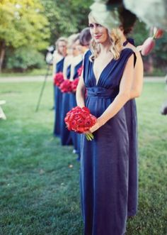 Gorgeous navy bridesmaid dresses with a pop of red with bouquets   Photo by Jess Graham Photography