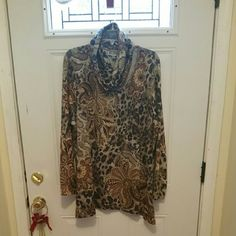 Top Ladies sexy lightweight sweater top, long sleeve. Animal print with a flower print trimmed in sequence. Scarf is detachable n secured with 2 buttons.  Worn once. Very soft touch. If interested make a reasonable offer n it's urs. JM Collection  Sweaters Crew & Scoop Necks