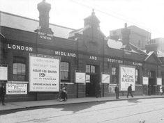 Posters outside East Ham station, , about 1928. The station came under the control of the London, Midland & Scottish Railway in 1923. It provided connections to the North West and to Scotland, as well as to France...