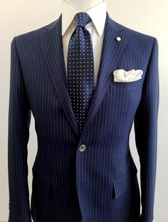 Pinstripes continue to be an important pattern for expanding your wardrobe. Here we chose a unique blue with a soft grey stripe pattern, matched with a Custom Made Off the Rack pinstripe shirt which features a tall white collar.