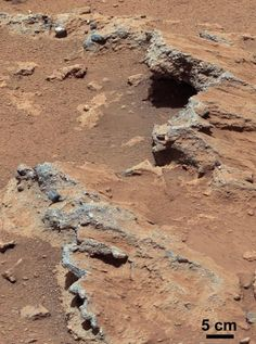 "NASA's Mars Science Laboratory (MSL) Curiosity rover found evidence for ancient, water-transported sediment on Mars at a few sites, including the rock outcrop pictured here, named ""Hottah."" Rounded pebbles within this sedimentary conglomerate indicate sustained abrasion of rock fragments within water flows that crossed Gale Crater."