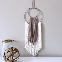 Creating a Yarn Wall Hanging is very simple and the results are stunning! Easy DIY Craft Tutorial Ideas for Inexpensive Home Decor. Yarn Wall Art, Wall Hanging Crafts, Yarn Wall Hanging, Metal Tree Wall Art, Diy Wall Art, Art Yarn, Metal Art, Macrame Wall Hangings, Crochet Wall Art