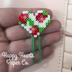 This planner Clip/ bookmark is the perfect way to bring in the spring time sunshine. Check out Happy Hearts Paper Co. on Etsy and Instagram for more fun planner ideas and Perler bead planner accessories and bookmarks. #planners #plannerclips #plannerideas #plannergirl #planneraddict #perlerbeads #bookmarks #pagemarker