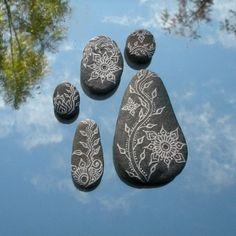 vining lotus painted pebbles. via Etsy.