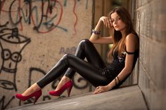Red shoes, leather jeans & grafitti wall