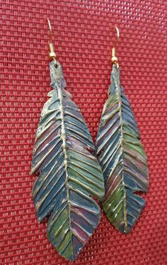 Check out this item in my Etsy shop https://www.etsy.com/listing/496354119/aluminum-cast-hand-painted-feather