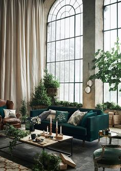 High ceiling, huge windows, and a lovely green sofa.