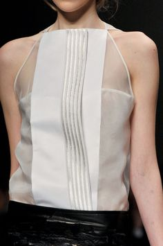 Sheer top with opaque layered panel; chic structured fashion details // Gianfranco Ferré
