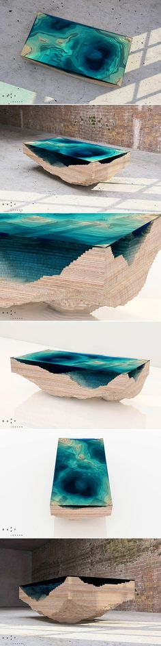 Not so long ago we wrote about the beautiful river- and lake-like desks by Greg Klassen, and today we have a similar but not less stunning layered glass table design by Duffy London - the Abyss table, which is created in a way that mimics the depths of the oceans. This unique table uses multiple layers of stacked glass and wood, completing the table as a three-dimensional representation of a geological map.