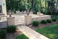 The patio design included a raised patio with a custom walkway, sitting walls and pillars with lights.
