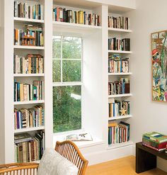 Books of all shapes and sizes complement the simple, sleek architecture of this custom bookshelf.