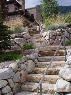 round stone walls and stone slab steps, Mediterranean style landscaping (Diy Step Railing) Outdoor Stair Railing, Front Porch Railings, Wrought Iron Stair Railing, Patio Steps, Outdoor Steps, Front House Landscaping, Landscaping A Slope, Paver Walkway, Stone Walkway