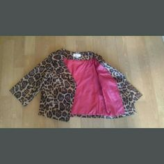 Retro 3/4 Sleeve Leopard Jacket Absolutely adorable leopard jacket - very retro style with big collar - 3/4 sleeves with cuff - hot pink lining - one button closure. I love this jacket but its too big - size 6 - made from 97% cotton 3% lycra - hot pink lining made from 100% polyester. 22 inches long in the front 20 inches long in the back. Price firm. No Holds - swaps or trades please. Newport News Jackets & Coats
