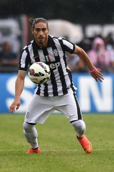 Martin Caceres of Juventus A in action during the preseason friendly...