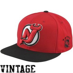Mitchell And Ness Sta3 New Jersey Devils Snapback Hat Red. Size: by Mitchell & Ness. $25.95. 80% Acrylic, 20% Wool Snap Back Cap. NHL Logo Embroidered on Left Side. Mitchell & Ness Wordmark Embroidered On Back. Raised Embroidery on Front. Green Undervisor. Low Cost 1 to 3 Day Expedited S/H. The Sta3 New Jersey Devils Snapback Hat From Mitchell & Ness Features:Color: Red - Black - White-Large Embossed New Jersey Devils Logo On The Front-Embossed NHL Logo On The Side-Two Tone Cap A...