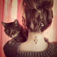 tiny cat tattoo on neck