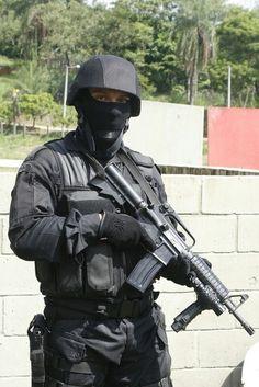 """Batalhão de Operações Policiais Especiais, """"Faca na Caveira"""" (Portuguese for """"Knife in the Skull""""), BOPE logo and motto"""