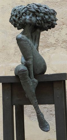 Beautiful sculpture of a young woman - just the right amount of detail.