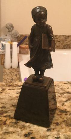 Little school girl bronze on a marble base.
