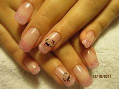Hello Kitty Nails with little glitter stones and black stamping.