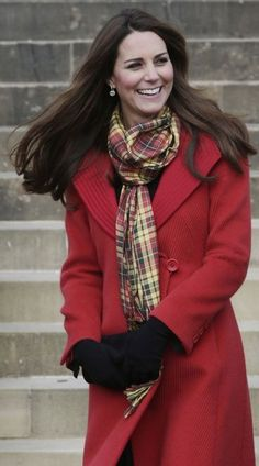 Lady in red: Kate wore a Strathearn tartan scarf as a nod to her Scottish title.