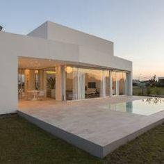 PERSPECTIVA DE FACHADA NORTE: Casas de estilo Minimalista por VISMARACORSI ARQUITECTOS