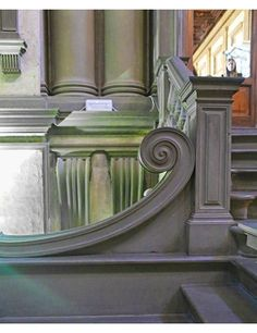 The library is full of both large and small visual moments. Seen as a whole, the stairs convey a sense of movement. But details, like the one shown here, are individual pieces of art.