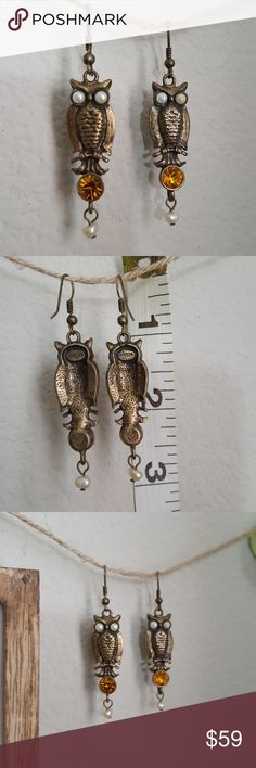 Vintage Gerard Yosca Bronze Owl Earrings Beautiful vintage pieces in excellent condition. Hook earrings with dangling owl perched upon a good topaz and pearl bead dangling and pearls for eye. Unique and beautiful! Vintage Gerard Yosca Bronze Owl Earrings Gerard Yosca Jewelry Earrings