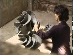 Ceramic sculpture The camera observes closely how Alexandra Engelfriet molds pieces of clay into an object of art. http://youtu.be/_d1dnEwM4W8