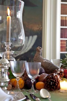 notice candle and love the pheasant with natural fruit casually layed directly on table   rustic and luxe
