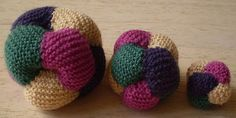 Berry Balls-This pattern is available as a free Ravelry download. Made from simple knitted squares, these balls are given their special shape with a needle and thread after they have been put together. Any yarn and needles can be used to make balls of any size.