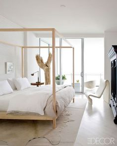 Lovely natural bedroom of a Miami condo designed by When Darryl Carter.
